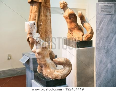 Ancient Triton Statues In Archaeological Museum