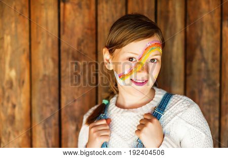 Close up portrait of adorable little kid girl with birthday party face painting