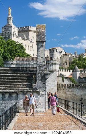 Tourists Walk To Palais Des Papes In Avignon