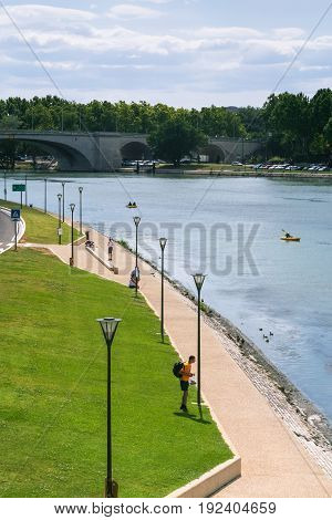 Tourists On Waterfront Of Rhone River In Avignon