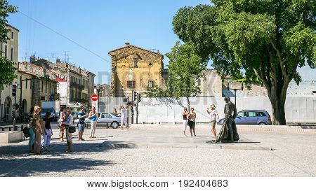 Tourists On Square Place Des Arenes In Nimes