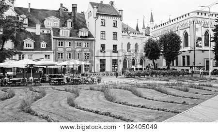 Lawn And Outdoor Cafe Near Houses In Old Riga Town