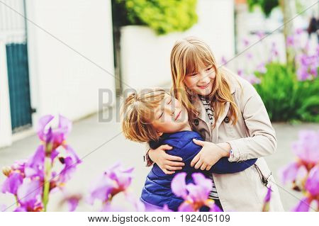 Two funny and happy kids playing together outdoors