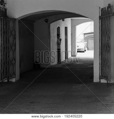 Man In Gateway On Valnu Iela Street