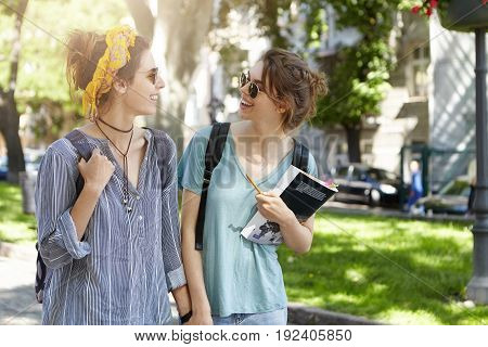 Homosexuality And Lifestyle Concepts. Beautiful Student Females Walking Outdoors Keeping Thier Hands