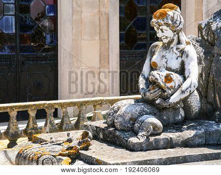 Statue On Fountain In Garden Of Estoi Palace