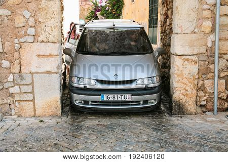 Car In Narrow Medieval Gateway In Old Faro City