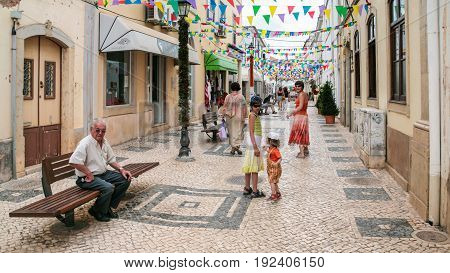 People On Street In Center Of Sives City