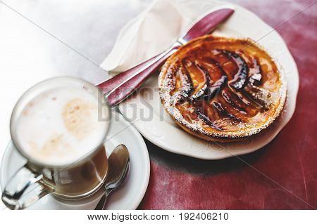 Tarte Tatin and latte macchiato top view
