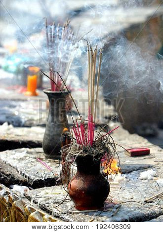 Incense Offering. Sticks of incense are burnt as an offering to Buddha