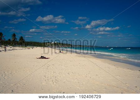 Beautiful beach with turquoise water in Tulum Mexico Mayan ruins on top of the cliff.