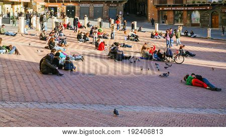 People Are Lying On The Pavement Of Piazza