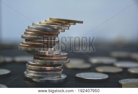 Closeup stack coin with blur background. Financial and saving concept.