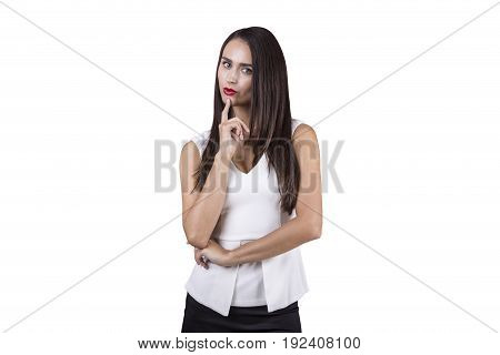Isolated portrait of a pensive businesswoman with dark hair and a red lipstick. She is wearing a white shirt and a black skirt. Concept of planning.