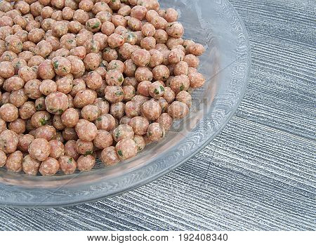 Pictures of tiny meatballs waiting to be juicy soup