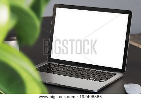 Close up of a laptop standing on an office or a home office desk. Blank screen. A large plant with green leaves in the foreground. 3d rendering mock up