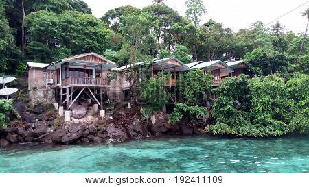 An inn on the beach with a rustic theme