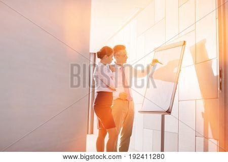 Business colleagues planning for presentation in office