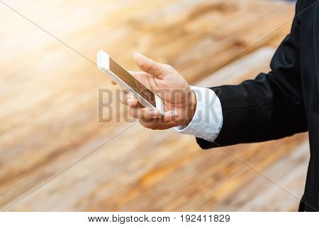 Close-up Smart Business Man Wearing Modern Black Suit And White Shirt And Texting On Mobile Smart Ph