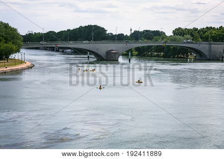 Rhone River With Bridge And Canoes In Avignon City