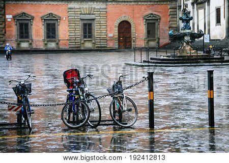 Wet Bicycles On Piazza Della Santissima Annunziata