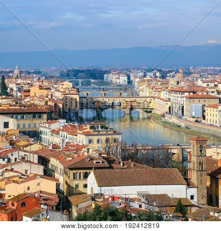travel to Italy - above view Arno River in Florence town from Piazzale Michelangelo in sunny winter day poster