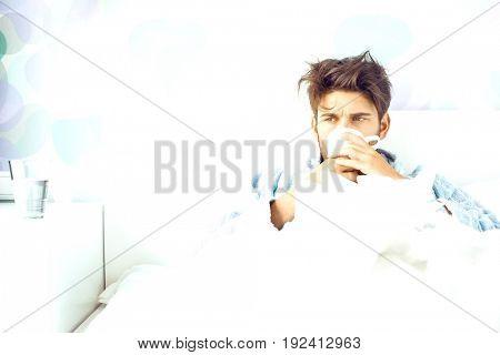Sick man having coffee in bed