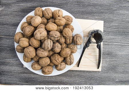 Plates of natural walnuts and walnut crumbs