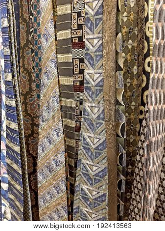 close up view of men's hanging silk necktie collection