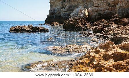Rocks On Coastline Of Beach Praia Maria Luisa