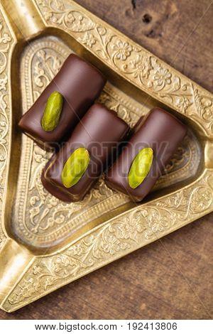 Handmade Luxury Chocolates With Pistachio. Top View