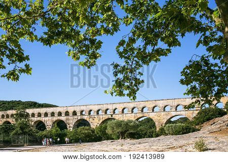 Tourists Go To Ancient Roman Aqueduct Pont Du Gard