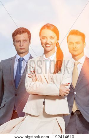 Portrait of confident businesspeople standing together against sky