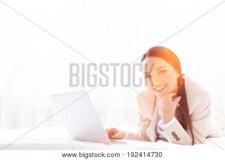Portrait of beautiful businesswoman using laptop in hotel