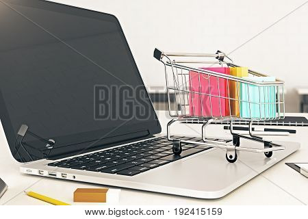 Side view of empty laptop screen with cart and colorful bags. Purchasing online concept. Mock up 3D Rendering