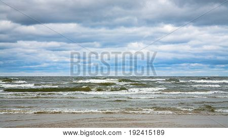 Low Gray Clouds Over Water Of Baltic Sea