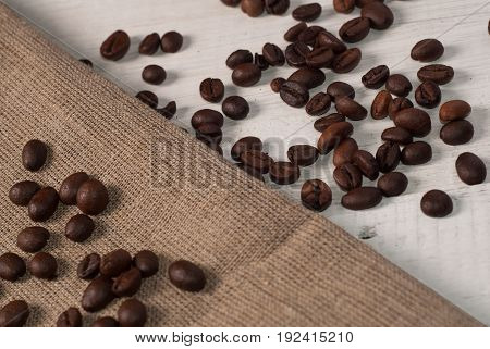 Coffee Beans On Wooden Background And Rough Cloth,