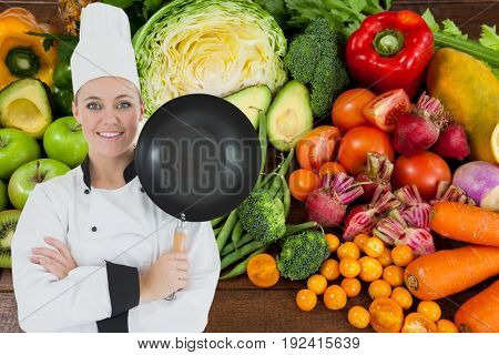 Digital composite of chef against vegetable background