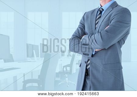 Digital composite of business man with folded hands