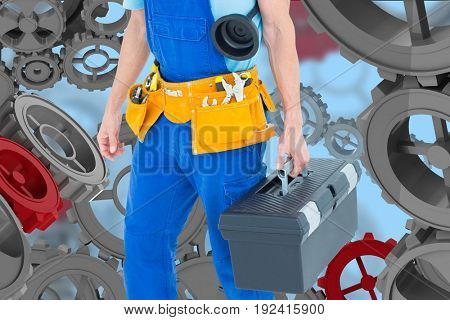 Digital composite of handyman against back with 3d cogs