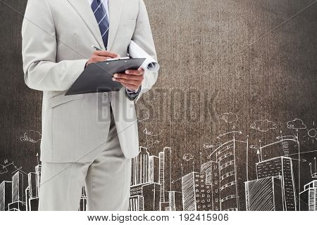 Digital composite of business man against grunge wall with city drawing