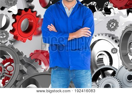 Digital composite of mechanic against background with 3d cogs