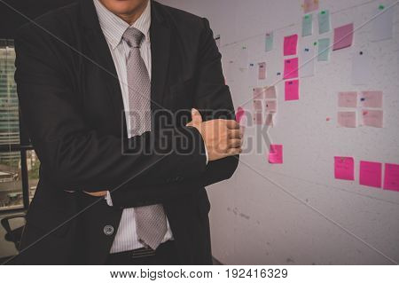 Male model in a suit posing on office background