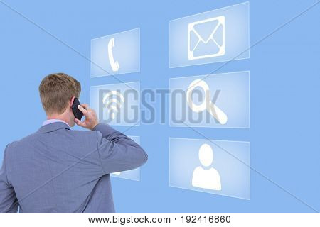 Digital composite of business man looking at interface