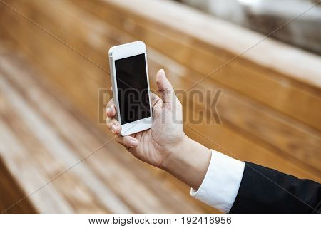 Business Concept - Young Business Man Check Mobile Phone For Meeting.