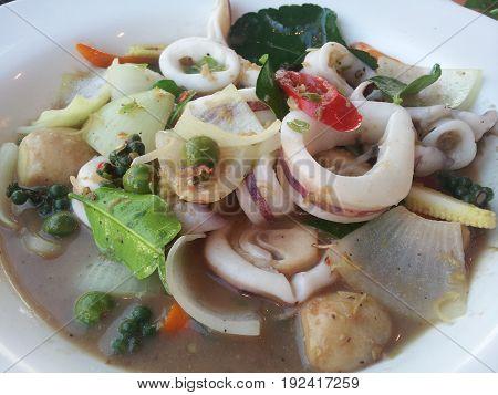 Spicy squid with mushroom, onion, turkey berry, lemon leaf