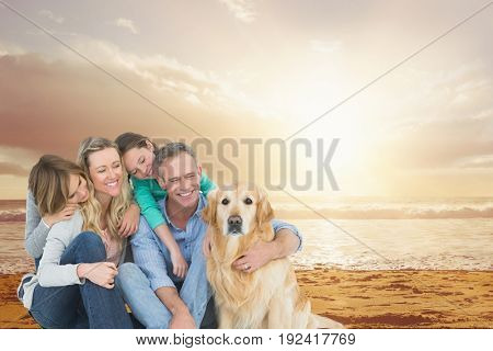 Digital composite of Smiling family with a dog on the beach