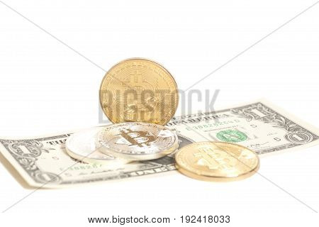 Golden end silver bitcoin coins on us dollars isolated on white