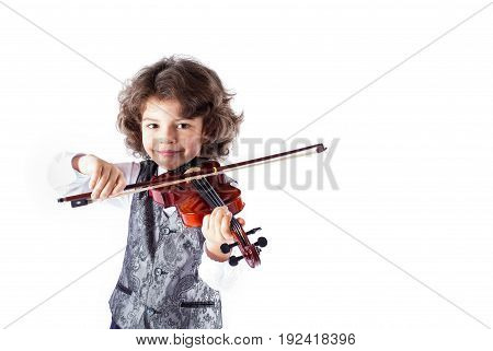 Little cute smiling violinist waistcoat in playing the violin. White background.