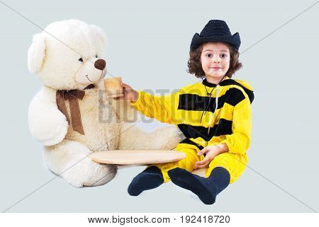 A cute little bee is feeding a bear. White background.